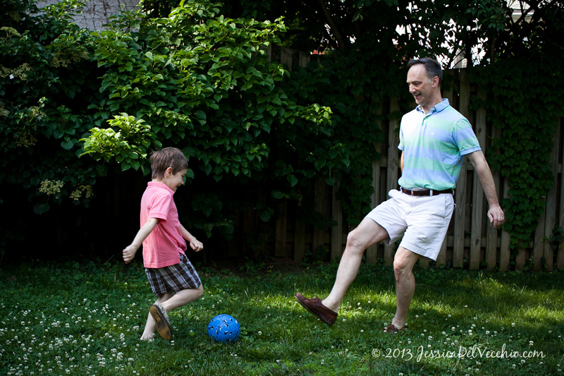 Backyard soccer playing at a Chevy Chase family portrait session