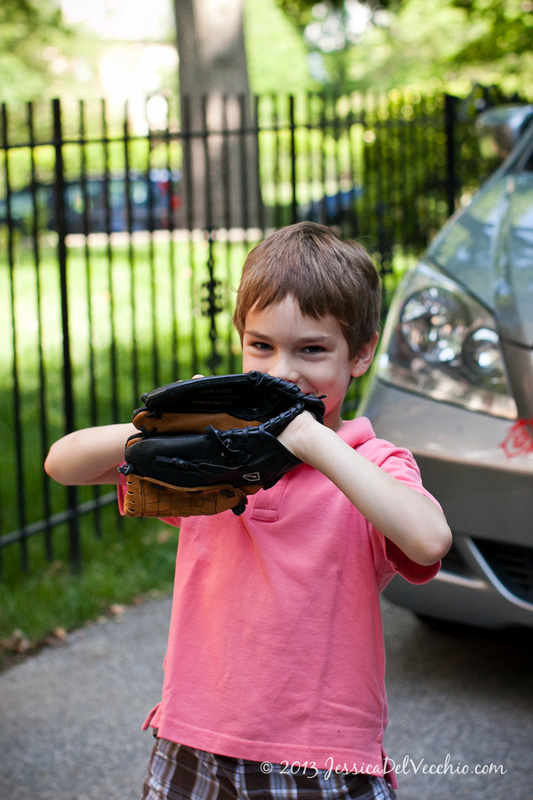 Breaking in a new baseball glove at a family portrait session in Chevy Chase